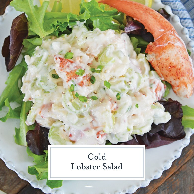 overhead view of cold lobster salad with chives on lettuce