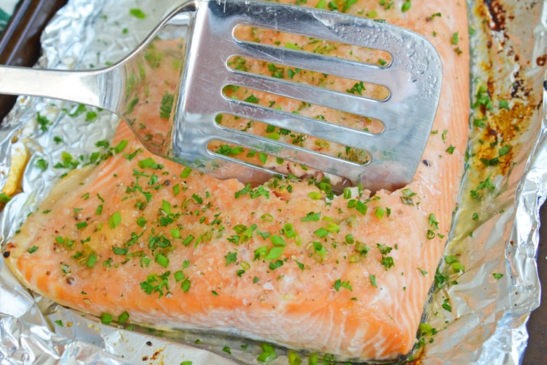 spatula cutting into baked salmon recipe