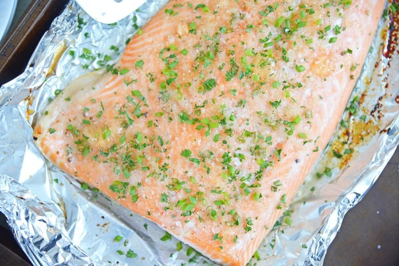 apple glazed salmon on a baking sheet