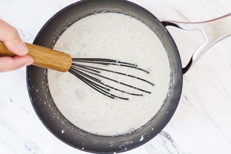 mixing milk, cream and cornstarch in a saucepan