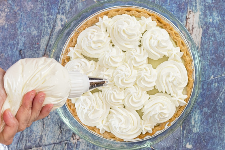 top with whipped cream swirls