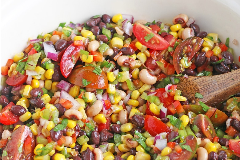 close up of texas caviar with a wood spoon