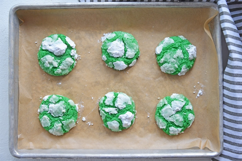 crinkle cookies on a baking sheet