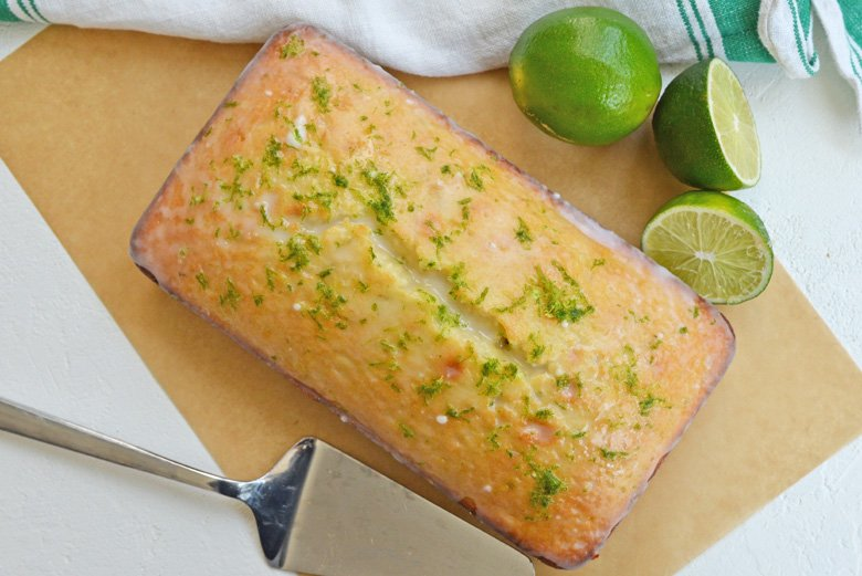 key lime loaf pound cake on a tan parchment paper