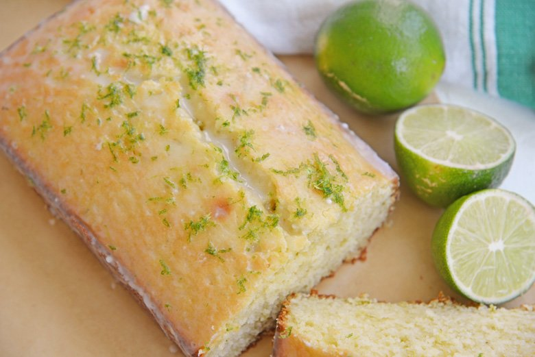 sliced key lime pound cake with fresh limes