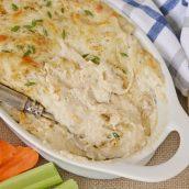 creamy hot crab dip in a casserole dish