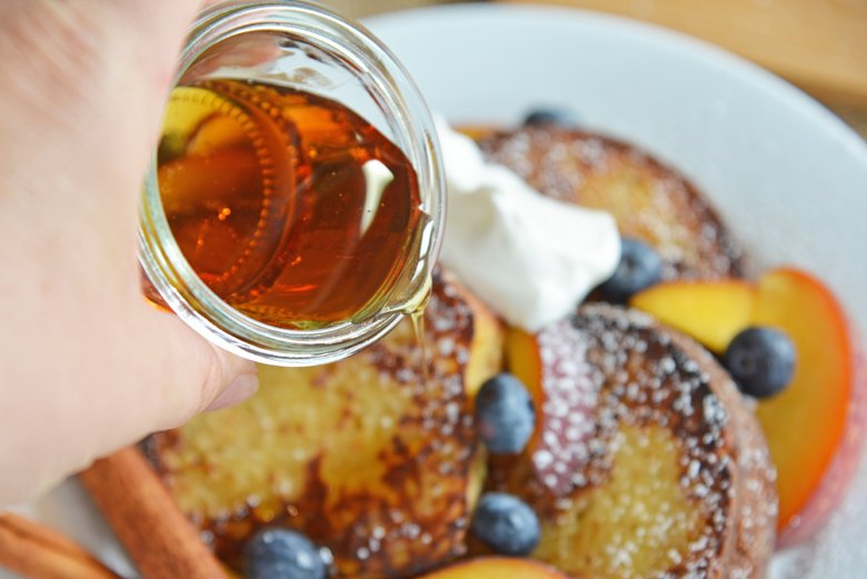 maple syrup pouring over fresh french toast