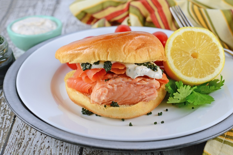 angle of salmon sandwich on brioche bun