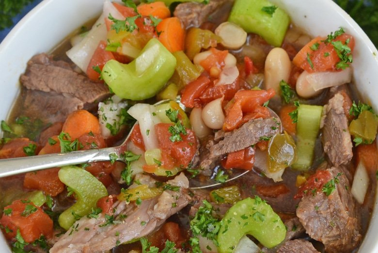 spoon of soup with vegetables and beef