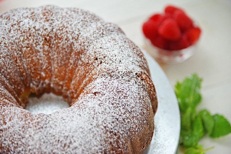 sour cream bundt cake with powdered sugar topping