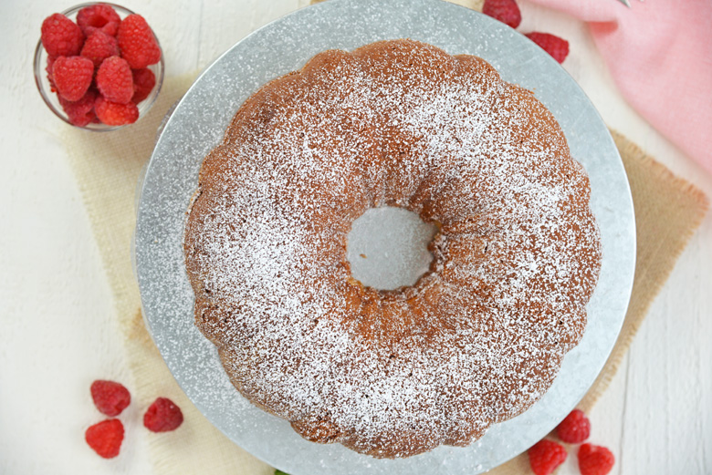 overhead of sour cream pound cake with powdered sugar dusting