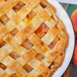 overhead of baked peach pie