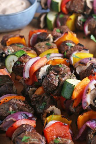 steak kabobs on a cutting board