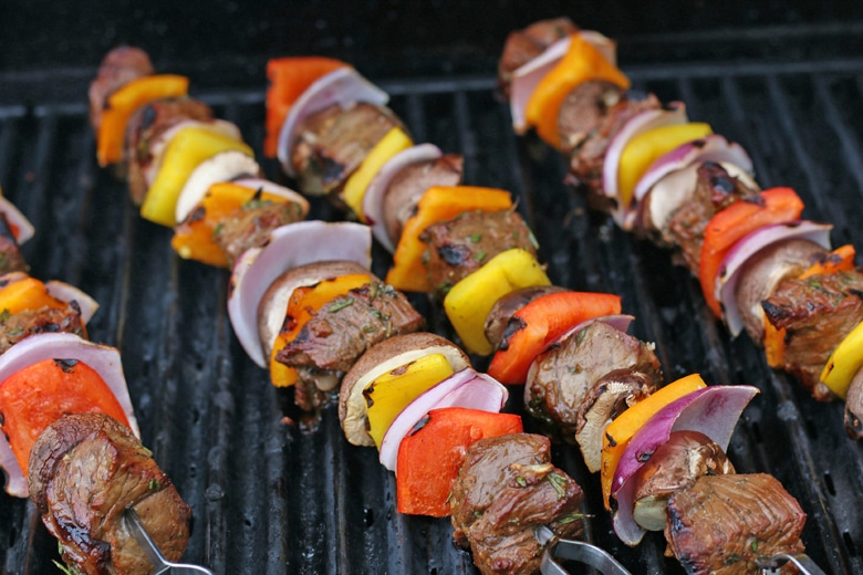 steak kabobs on a grill