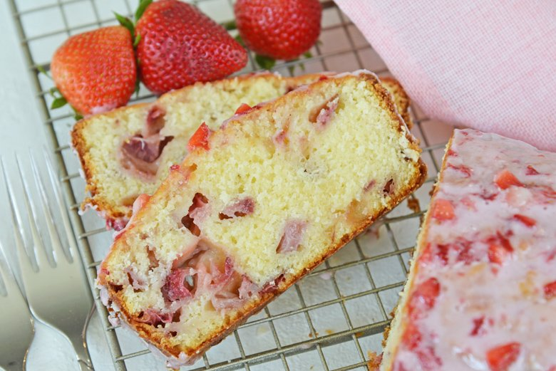 slices of strawberry pound cake on a cooling rack