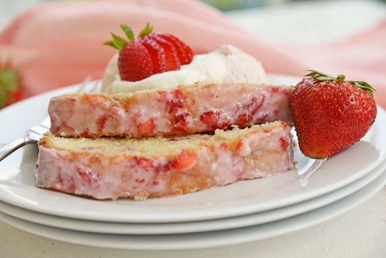 strawberry pound cake slices on white plates with fresh strawberries