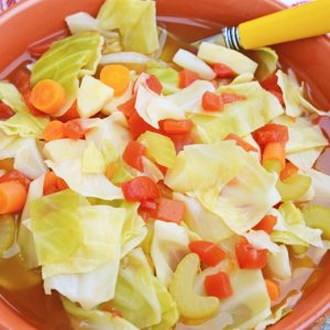 colorful cabbage soup in an orange bowl