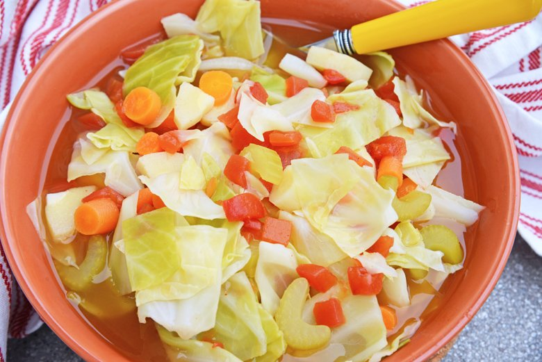 close up of healthy cabbage soup in a bowl