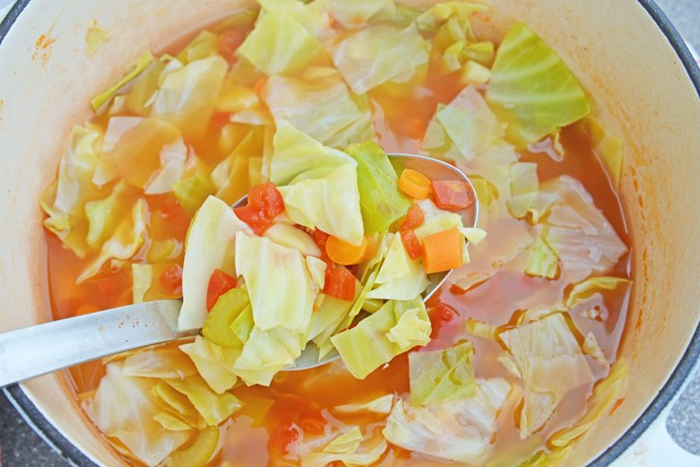 cabbage soup in a dutch oven simmering