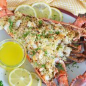 whole stuffed lobster with butter and lemons