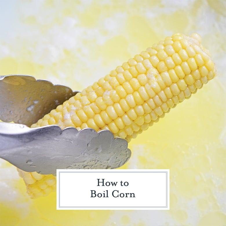 tongs holding an ear of corn