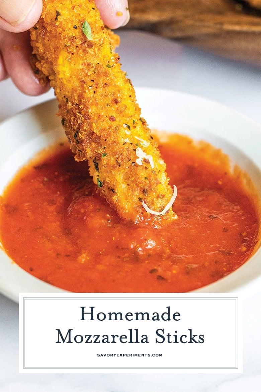 fried mozzarella dipping into tomato sauce