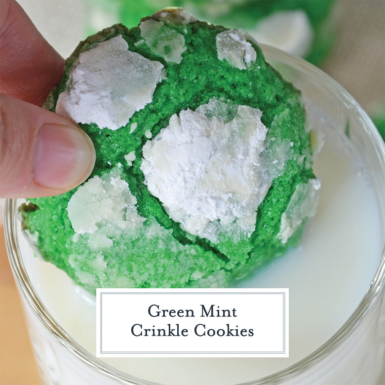 green crinkle cookie dipping into a glass of milk