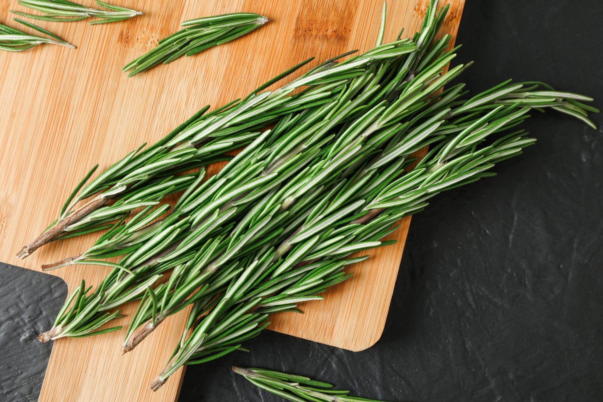 fresh rosemary on a cutting board