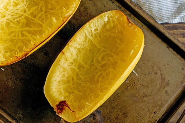 spaghetti squash halve on a baking sheet