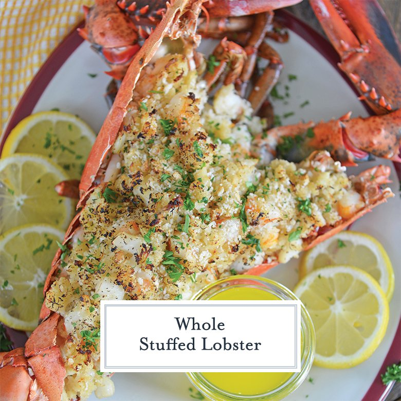 seafood stuffed lobster on serving platter with lemon slices