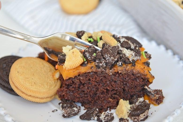 fork digging into poke cake