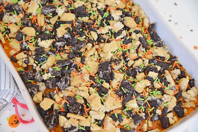 overhead of halloween poke cake with sprinkles