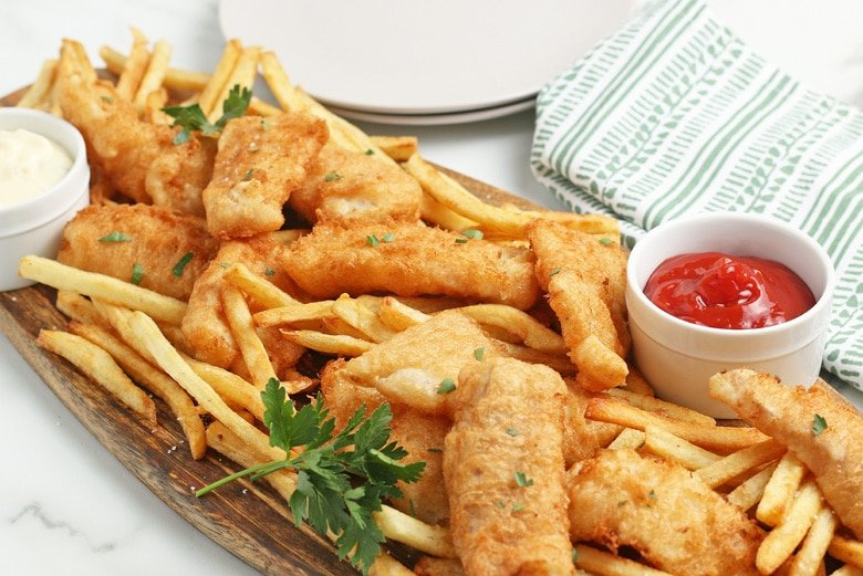 angle view of fried fish with french fries
