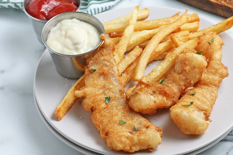 beer battered cod on a plate