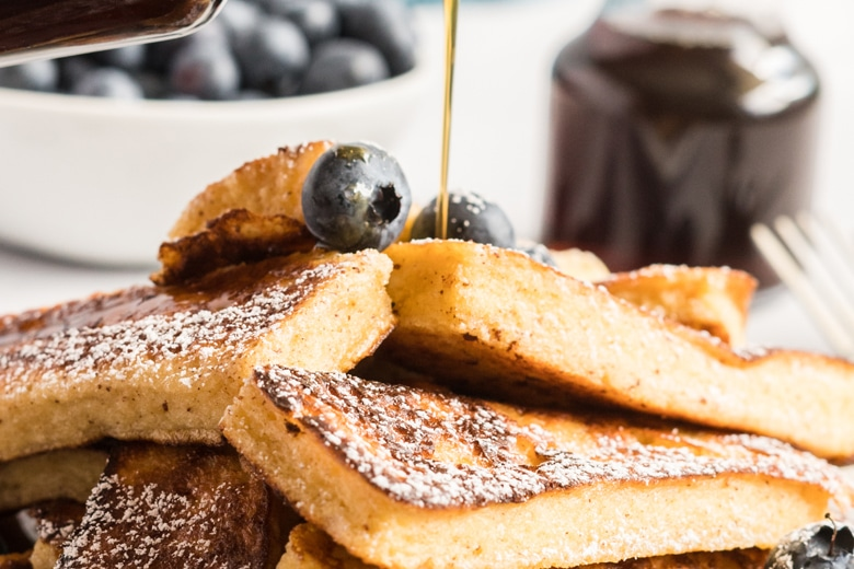 syrup pouring over French Toast Sticks