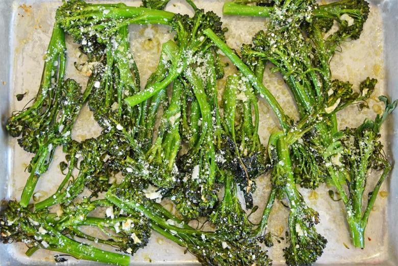 garlic parmesan broccolini on a baking sheet