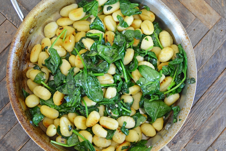gnocchi with spinach in a frying pan