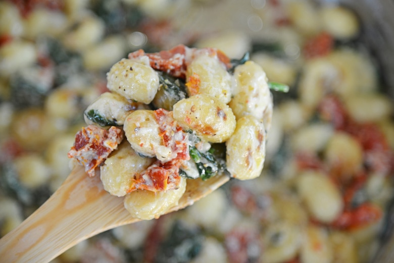 wooden spoon with creamy gnocchi
