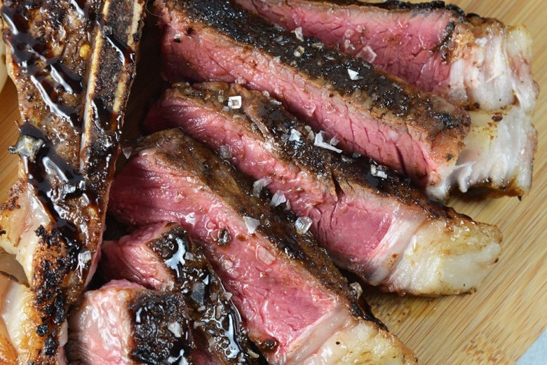 close up of sliced t-bone steak