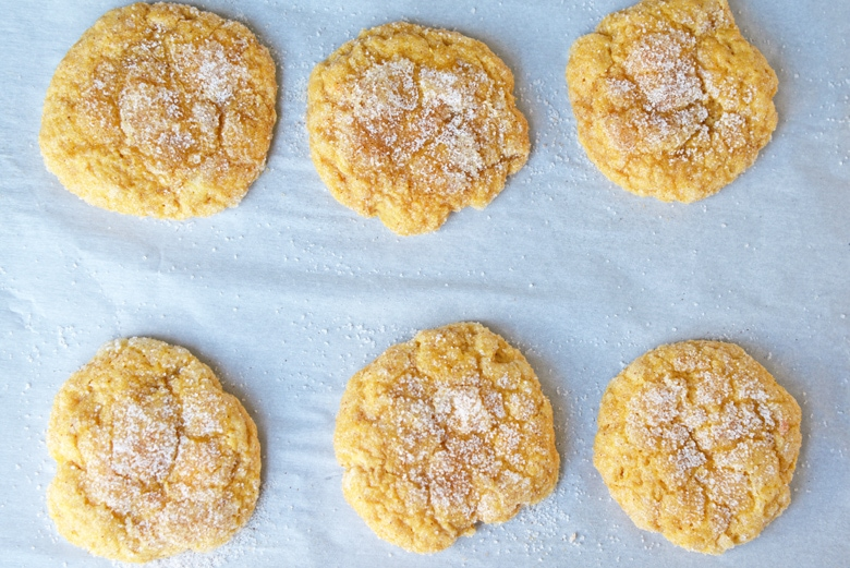 pumpkin sugar cookies on a baking sheet