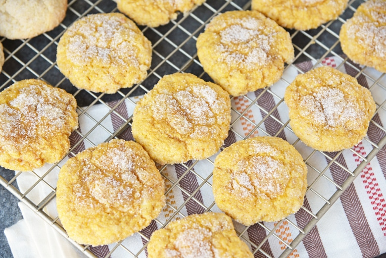 sugared pumpkin cookies on a wire rack