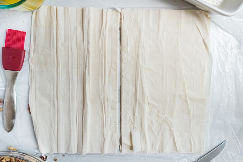 sheets of phyllo dough cut in half