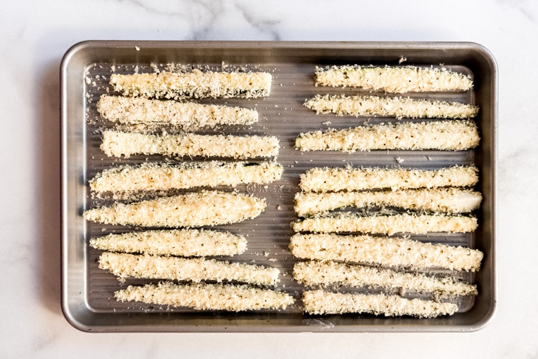 zucchini strips on a baking sheet