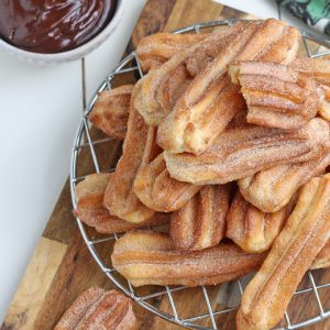 air fryer churros on a serving platter