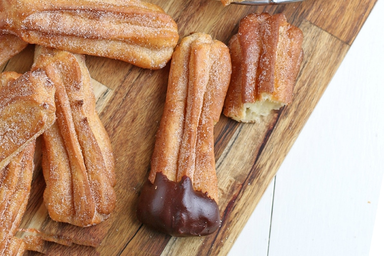 churro dipped in chocolate sauce