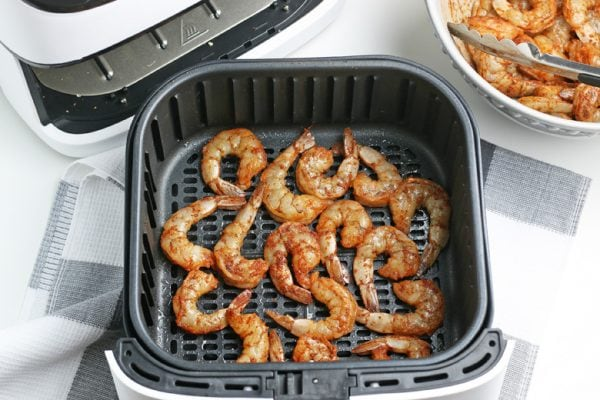 shrimp cooking in an air fryer