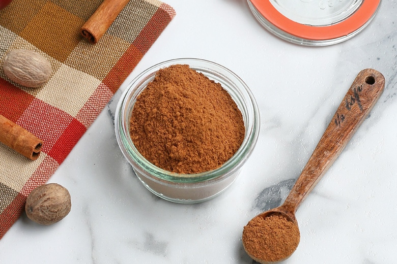 glass container with homemade apple pie spice