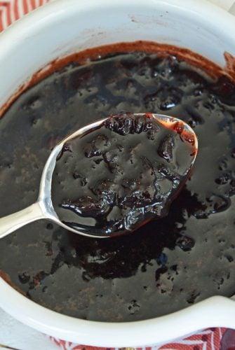 spooning cherry balsamic sauce