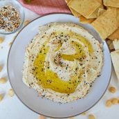 overhead of hummus with olive oil and everything seasoning