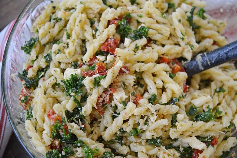kale pasta salad in a mixing bowl